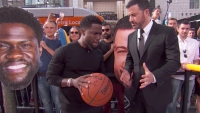 Kevin Hart and Jimmy Kimmel playing basketball.