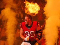 J.J. Watt #99 of the Houston Texans is introduced before playing against the New England Patriots