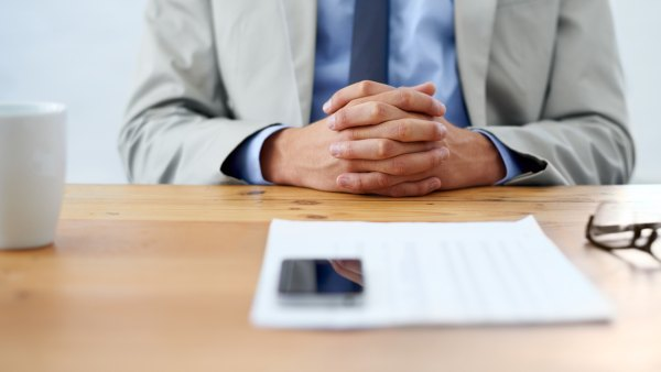Man Sitting at Desk for Job Interview
