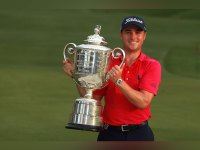 Justin Thomas of the United States poses with the Wanamaker Trophy after winning the 2017 PGA Championship during the final round at Quail Hollow Club on August 13, 2017 in Charlotte, North Carolina.