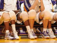 Basketball Players Ice Their Knees