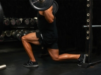Man Squats With a Barbell