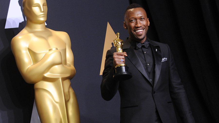 Actor Mahershala Ali poses in the press room at the 89th annual Academy Awards.