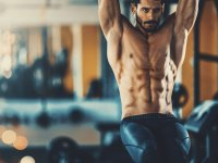 Fit man doing L-sit abs exercise