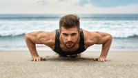 Man Performing Pushup On Beach