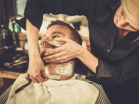 Man Getting Shaved at Barber Shop