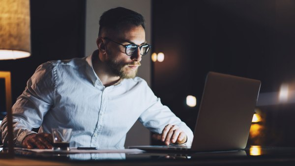 Businessman working late at night in office