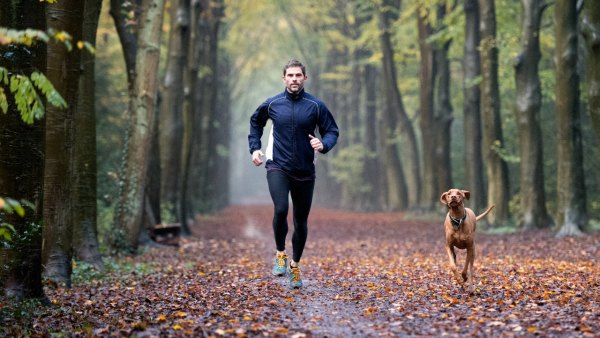 Man running with dog on trail