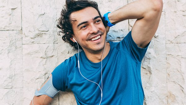 Man Smiles While Taking A Rest During A Workout