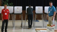 Man voting in polling booth during election