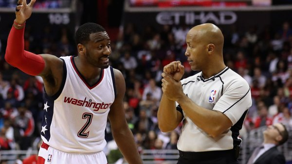 John Wall #2 of the Washington Wizards argues with NBA referee Marc Davis
