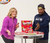 Marshawn Lynch appears on EVITE to sell Skittles with Allison Waggoner