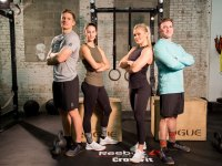 'Men's Fitness' editors and CrossFit athletes posing