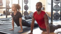 Man and woman mindfully exercising