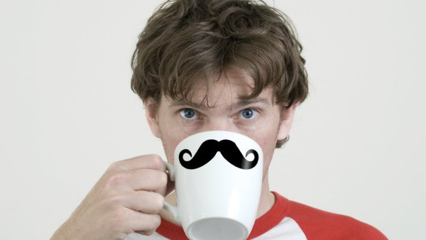 Man drinking from moustache mug