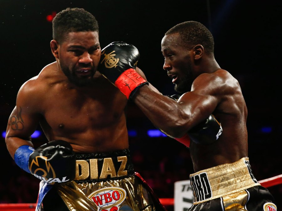 Terence Crawford (R) connects with Felix Diaz