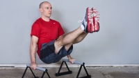 Get Big: 5 Must-Try Moves With Parallette Bars