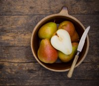 Pears in a bowl with knife
