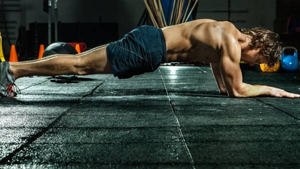 Fit man doing plank