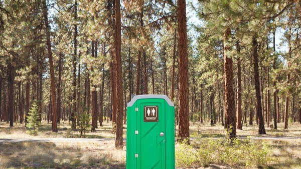 Porta Potty in woods