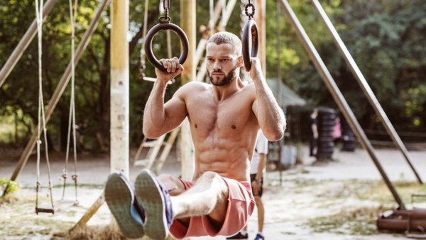 Man Swinging From Park Rings Pullup