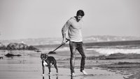 Liam Hemsworth on the Beach With Dog