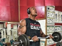 The Rock works out lifts weights on Instagram