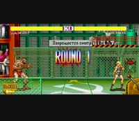 """Ronda Rousey's digital avatar faces off against Zangief in a """"Street Fighter II"""" spoof."""