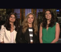 """Ronda Rousey promotes her """"Saturday Night Live"""" appearance with castmember Cecily Strong and musical guest Selena Gomez."""