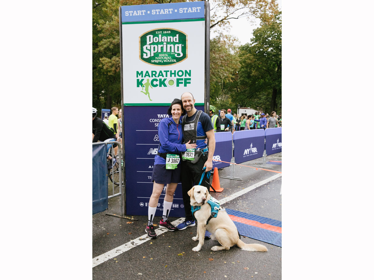 Thomas Panek running with guide dog Gus and wife Melissa