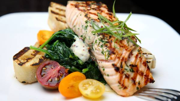 The grilled salmon at Top of the Hub restaurant, located on the 52nd floor of the Prudential Tower in Boston, July 13, 2016.