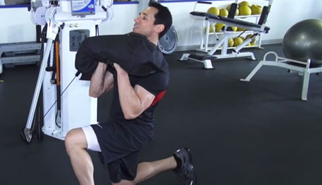 Exercise to Know: Kneeling Sandbag Press