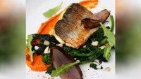 Sea Bass with Romesco Sauce, Broccoli Rabe, and Baked Red Onion