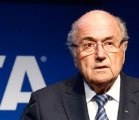 WATCH: FIFA Exec Sepp Blatter Gets Showered With Money (And He's Not Amused)