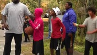 Shaquille O'Neal plays basketball with kids and police officers in Gainesville, Florida.