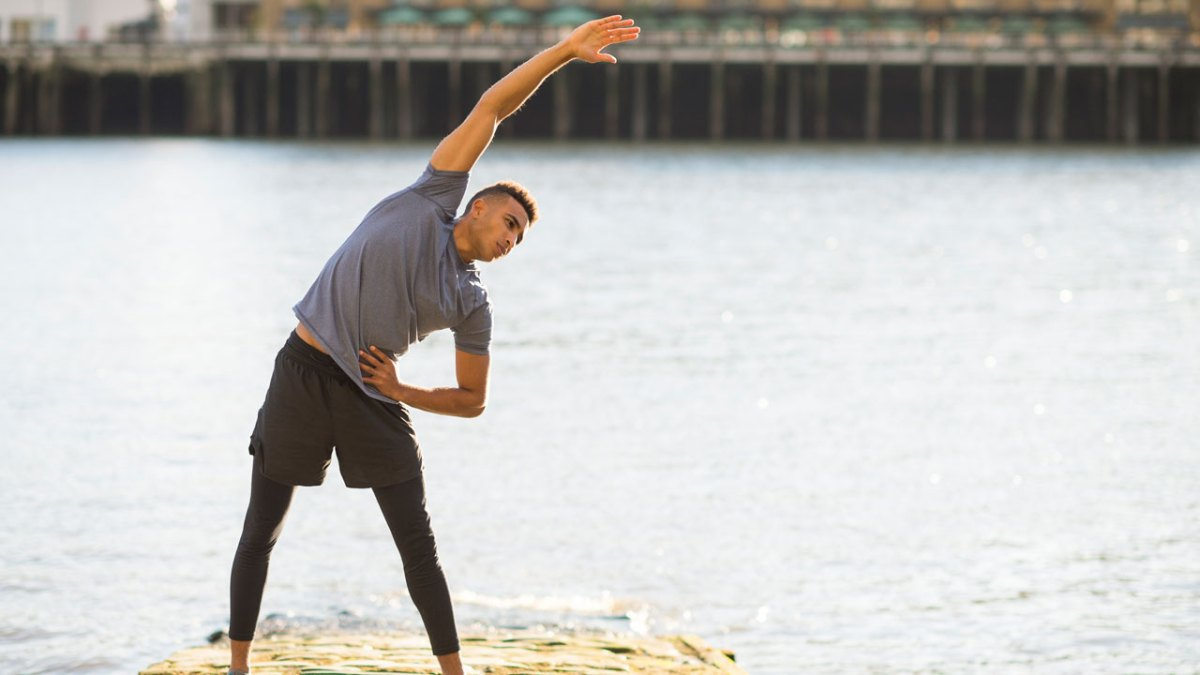 The 10 Best Stretches for Men, According to 10 Trainers