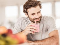 Man drinking smoothie
