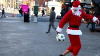 Check out this soccer playing Santa