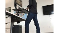 The Reason Using a Standing Desk Might Help You Lose Weight
