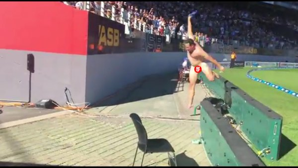 Watch: Naked fan storms field, loses to a wall (NSFW)