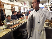 Kevin Santimino Holds A Fresh King Salmon Before Cleaning It At The Swan Oyster Depot In San Francisco, CA.