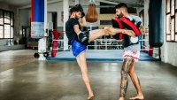 Men with tattoos kickboxing