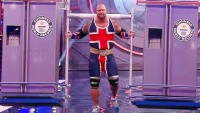 Thor Bjornsson carries two refrigerators during a Guinness World Record attempt.