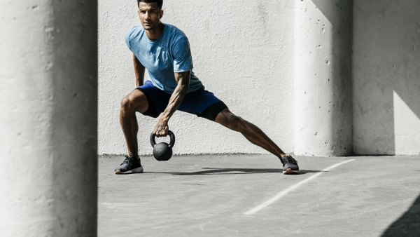 Man wearing Saxx apparel training with kettlebell