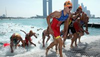 Triathlon Swimmers Exiting Water