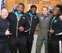 The New Day (Big E, Kofi Kingston, and Xavier Woods) with servicemen at WWE Tribute to the Troops.