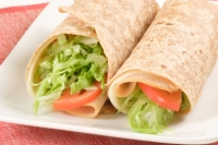 5. Turkey, low-fat cheddar cheese, & tomatoes on a whole-wheat wrap