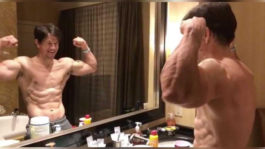 Mark Wahlberg flexing with Performix supplements
