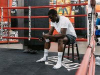 Fit man wearing Men's Ali x Bombas collection socks in boxing ring