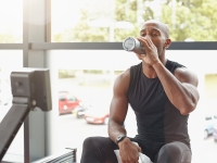 Man Drinks Water After Workout